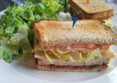 Clubhouse Sandwich with Caesar salad